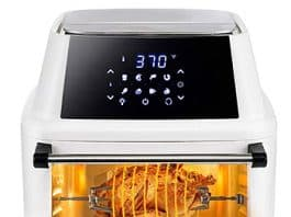 air fryer with glass front, showing a chicken cooking inside